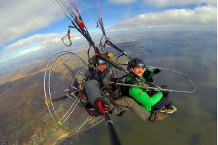 Flying on a paramotor with an instructor in tandem