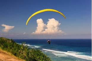 Flying on a paraglider with an instructor in tandem