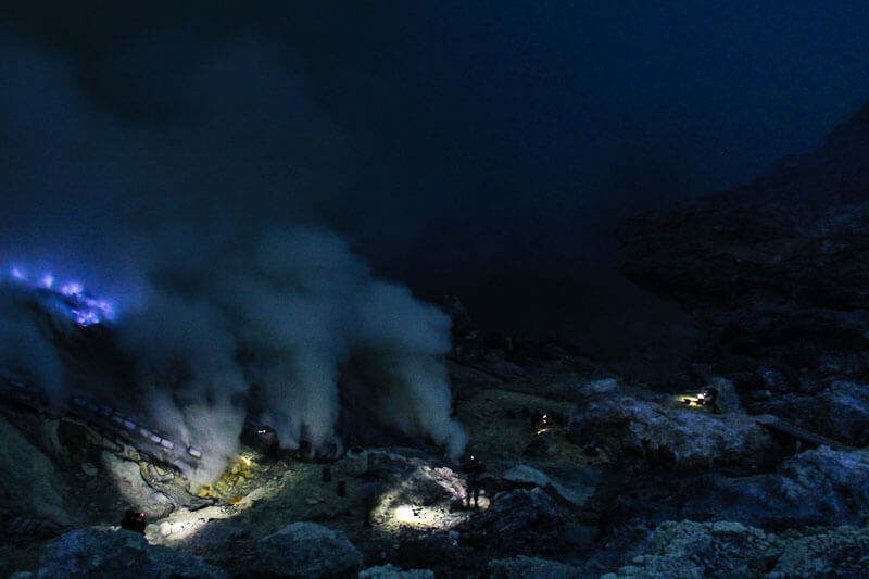 Ijen volcano | Blue flame and sunrise in a crater